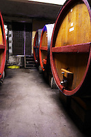 In the winery, big wooden storage vats for aging.  Domaine la Tourade, André Andre Richard, Gigondas, Vacqueyras, Vaucluse, Provence, France, Europe