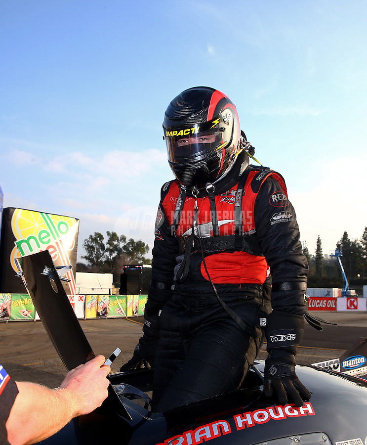 Feb 9, 2014; Pomona, CA, USA; NHRA top alcohol funny car driver Brian Hough celebrates after winning the Winternationals at Auto Club Raceway at Pomona. Mandatory Credit: Mark J. Rebilas-
