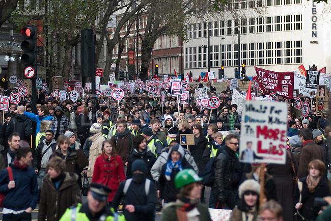 On the fourth day of demonstrations, as Parliament is about to vote on tuition fee rises, a large amount of protesters make their way down Kingsway in central London. 09/12/10