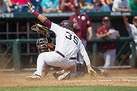 Mississippi State first baseman Wes Rea (35) and Oregon State catcher Jake Rodriguez (13) look to the umpire for a call during Game 11 of the 2013 Men's College World Series against the Oregon State Beavers on June 21, 2013 at TD Ameritrade Park in Omaha, Nebraska. Rea was called out. The Bulldogs defeated the Beavers 4-1, to reach the CWS Final and eliminating Oregon State from the tournament. (Andrew Woolley/Four Seam Images)