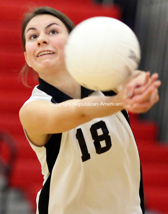 Southbury, CT-17 October 2011-101711CM06-   Pomperaug's Sarah Theriault bumps the ball during a volleyball match against Stratford Monday night in Southbury.  Pomperaug won 3-2.  Christopher Massa Republican-American