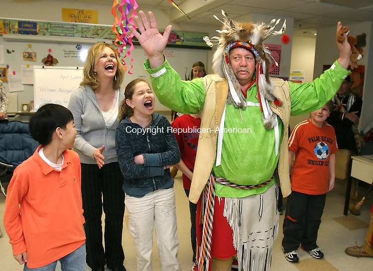TORRINGTON, CT 04/01/08- 040108BZ01- Mohegan tribe member Two Bears gets a laugh from Brian Peck, teacher Karen Schick, Miranda Gordon, Jonah Heiland (behind Two bears) and Mitchell Canty after explaining that a phrase he had them saying actually meant &quot;I am turkey.&quot;  Four members of the tribe were visiting the Vogel-Wetmore School's talented and gifted program on a grant.<br /> Jamison C. Bazinet Republican-American