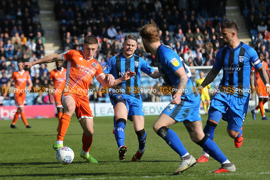 Greg Docherty of Shrewsbury Town tries to shake off a challenge from Gillingham's Mark Byrne during Gillingham vs Shrewsbury Town, Sky Bet EFL League 1 Football at The Medway Priestfield Stadium on 13th April 2019