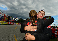 Sept 9, 2012; Clermont, IN, USA: NHRA pro stock driver Dave Connolly (right) is congratulated by teammate Erica Enders after winning the US Nationals at Lucas Oil Raceway. Mandatory Credit: Mark J. Rebilas-
