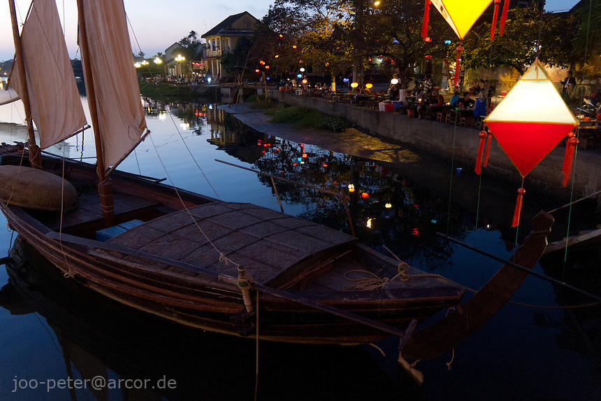 boats on River Hoai at sunset time with lamps shining,  Vietnam