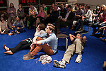 October 16, 2012. Raleigh, North Carolina.. (from left, at front) Sarah Werner, Jordan Dale Young and Joseph Huberman stayed for the entire debate.. Locals gathered at the Contemporary Art Museum to see artist Jonathan Horowitz's simultaneous exhibitions about the presidential election titled ?Your Land/My Land?..  A room is divided in two, with blue carpet, democrats on one side, and red carpet, republicans, on the other. TV's on both sides are supposed to play either FOX news, red, or CNN, blue. Because of the audio delay between the 2 channels, both sides played CNN during the 2nd presidential debate..