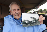 NWA Democrat-Gazette/FLIP PUTTHOFF<br />BIRTHDAY RIDE<br />Ryland Whitaeker, 98, of Tontitown shows a picture taken in 1937 when he was 18 years old of Whitaeker next to his Ford Model A he purchased for $65. Whitaeker shows the photo before taking a ride Saturday July 15 2017 in a real Ford Model A Roadster courtesy of its owner, James Stewart of Benton. Whitaeker's great grandson, Logan Hood, arranged the ride in honor of his great grandfather's 98th birthday. After Whitaeker bought his Model A as a teenager, he spray painted it silver and named it &quot;The Silver Streak,&quot; said Whitaeker's granddaughter, Robin Hood.
