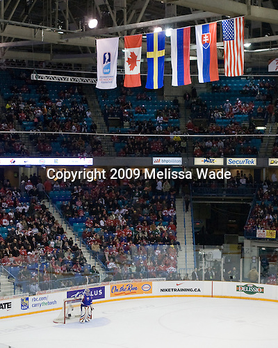 The flags of the participating nations hang above the ice. - Team Canada defeated Team Slovakia 8-2 on Tuesday, December 29, 2009, at the Credit Union Centre in Saskatoon, Saskatchewan, during the 2010 World Juniors tournament.