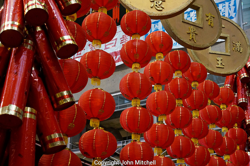 Firecrackers, coins, and Chinese lanterns hang from the ceiling at Chinese New Year celebrations in Chinatown, Vancouver, BC, Canada. The 2014 celebrations mark the beginning of the Year of the Horse in the traditional Chinese lunar calendar.
