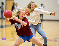 NWA Democrat-Gazette/JASON IVESTER <br /> Emily Siler (left) and Cortney (cq) Van Wilde (cq), both Rogers Heritage High seniors, look to throw during a game of dodgeball on Thursday, Nov. 12, 2015, at the school. Seventeen teams paid a $20 entry fee and student spectators paid $1 to raise money for United Way of Northwest Arkansas. Winning teams will compete in the championship of the tournament today (FRIDAY).