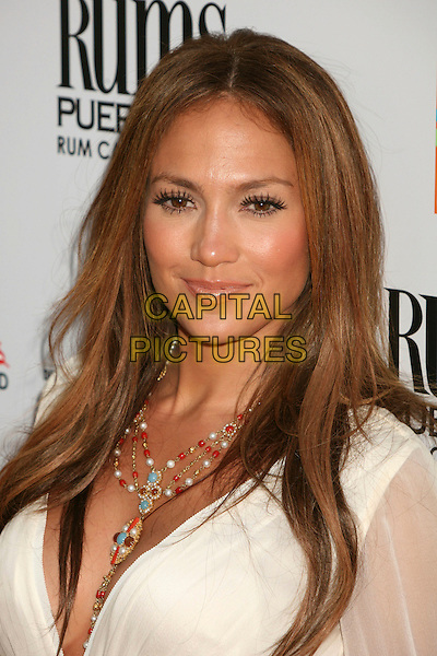 "JENNIFER LOPEZ.The Picturehouse L.A. Premiere of ""El Cantante"" held at The DGA in West Hollywood, California, USA..July 31st 2007.headshot portrait turquoise gold pearl coral bead cross necklace false eyelashes .CAP/ADM/BP.©Byron Purvis/AdMedia/Capital Pictures"