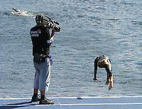 29 JUL 2007 - SALFORD, UK - An ITU television cameraman films a competitor warming up - Salford ITU World Cup Triathlon. (PHOTO (C) NIGEL FARROW)