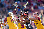 Los Angeles, CA 02/09/13 - Haleigh Dalmass (USC #8), Kaitlyn Couture (USC #18) and Jess Carroll  (Northwestern #21) in action during the Northwestern vs USC NCAA Women Lacrosse game at the Los Angeles Colliseum.