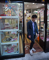 Man is coming out from the Pet shop in Shibuya, Tokyo