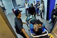 Venezuelan first aid squad transport a drug overdosed patient into the state hospital in Caracas, Venezuela, 25 June 2006.