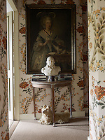 Outside the master bedroom a console table displays a Louis XVIII bust with a Westie-shaped pyjama bag underneath whilst the 18th-century painting on the wall behind is a portrait of a Venetian marquise