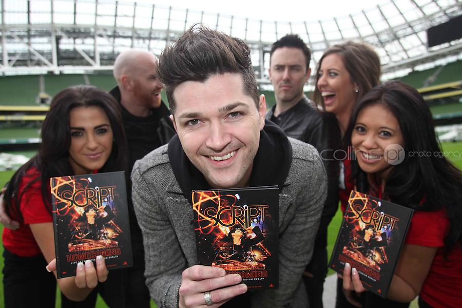 """NO REPRO FEE: 1.12.2011: Irish trio The Script pictured at the Aviva Stadium Dublin to mark the release of their first concert DVD """"HOMECOMING: LIVE AT THE AVIVIA STADIUM DUBLIN"""" filmed by acclaimed director Dick Carruthers ( Oasis, White Stripes, Paul McCartney.) 98FM's Thunder Trio Jeri Mahon, Mary Scott and Angela Frawley joined band members Danny, Mark and Glen reliving the experience of playing on home turf to a 54,000 strong crowd! The Script were back in Dublin earlier this year on July 2nd to play the sold-out show, the event that marked the pinnacle of the band's career to date coming just 3 years after their 1st gig at Dublin's Sugar Club in front of 28 people. The DVD is of the entire concert, includes their hits """"The Man Who Can't be Moved"""", """"Nothing"""" and """"Breakeven."""" Pictured (l-r) at the DVD launch was 98FM's Thunder Trio Angela Frawley, Mary Scott and Jeri Mahon with Script band members Mark Sheehan, Danny O'Donoghue and Glen Power. Picture Collins."""