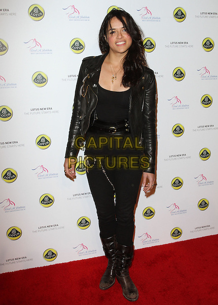 MICHELLE RODRIGUEZ .U.S. Launch Event for New Lotus Carst held at A Private Residence, Los Angeles, CA, USA, .12th November 2010..full length black leather jacket top belt jeans trousers boots  .CAP/ADM/KB.©Kevan Brooks/AdMedia/Capital Pictures.