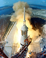 Kennedy Space Center (FLA) USA - 7/16/1969 -<br /> At 9:32 a.m. EDT, the swing arms move away and a plume of flame signals the liftoff of the Apollo 11 Saturn V space vehicle and astronauts Neil A. Armstrong, Michael Collins and Edwin E. Aldrin, Jr. from Kennedy Space Center Launch Complex 39A.