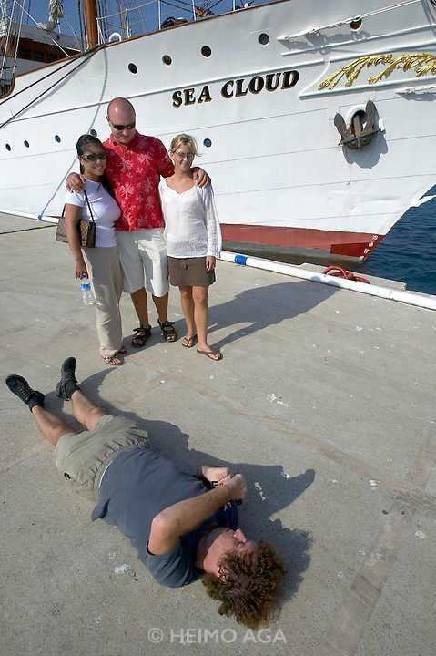 The Sea Cloud at the harbour. Michael Tesone photographing his friends before boarding.
