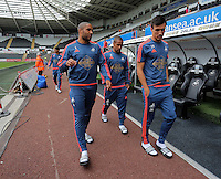 Pictured L-R: Ashley Williams, Wayne Routledge and Jack Cork of Swansea arrive Sunday 30 August 2015<br /> Re: Premier League, Swansea v Manchester United at the Liberty Stadium, Swansea, UK