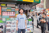 "The artist Kimou ""Grotesk"" Meyer poses in front of his ""T. SQ Newsstand""  in Times Square in New York on Friday, October 9, 2015. Created by the artist Kimou ""Grotesk"" Meyer with Victory Journal and Juxtapoz Magazine, the pop-up displays and sells art and culture zines created by a litany of artists. It will be in business at the crossroads of the world until October 18. (© Richard B. Levine)"