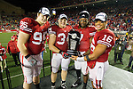 Wisconsin Badgers captains from left, Patrick Butrym (95), Bradie Ewing (34), Aaron Henry (7) and Russell Wilson (16) hold the Leaders Division Trophy after an NCAA Big Ten Conference college football game against the Penn State Nittany Lions on November 26, 2011 in Madison, Wisconsin. The Badgers won 45-7. (Photo by David Stluka)