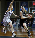 SIOUX FALLS, SD: MARCH 19:  Megan Smith #42 of Indiana (PA) drives on Elizabeth Grip #5 of Stonehill during their game at the 2018 Division II Women's Elite 8 Basketball Championship at the Sanford Pentagon in Sioux Falls, S.D. (Photo by Dick Carlson/Inertia)