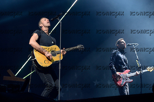 COLDPLAY - Chris Martin and Guy Berryman - performing live on the Main Stage on Day Two of the BBC RADIO ONE BIG WEEKEND at Glasgow Green in Glasgow Scotland UK - 24 May 2014.  Photo credit: George Chin/IconicPix