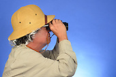 Man with pit helmet glasses and binoculars stock photo