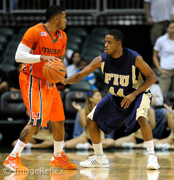 12 December 2008:  FIU's Marcus Crawford (44) defeds Miami's James Dews (23) in the first half of the Miami 76-50 victory over FIU at the BankUnited Center in Coral Gables, Florida.