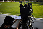 A BBC cameraman taping the players photographs to the perimeter fence at the UTS Stadium before the FA Cup fourth qualifying round match between Dunston UTS and their local rivals Gateshead. Founded in 1975, the home team were formerly known as Dunston Federation. The visitors won 4-0 watched by a record crowd of 2,500.