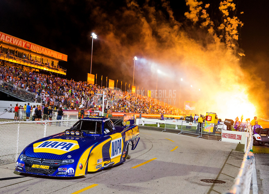Sep 5, 2015; Clermont, IN, USA; Fireworks explode as the car of NHRA funny car driver Ron Capps is towed back to the pits during qualifying for the US Nationals at Lucas Oil Raceway. Mandatory Credit: Mark J. Rebilas-USA TODAY Sports