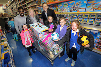 Pictured: Nathan Dyer and Gylfi Sigurdsson Wednesday 08 December 2016<br />Re: Swansea City FC players have bought Christmas gifts for 60 children at Smyths toy store in Swansea, south Wales.