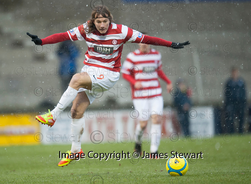 Accies Stevie May totally misses the ball as he tries to take a shot at goal.