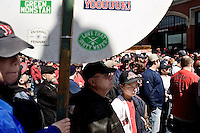 Fans wait to enter Fenway Park before the 2011 season opening game for the Boston Red Sox in Boston, Massachusetts.