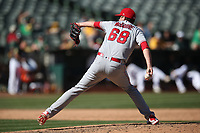 OAKLAND, CA - SEPTEMBER 20:  Deck McGuire #68 of the Los Angeles Angels of Anaheim pitches against the Oakland Athletics during the game at the Oakland Coliseum on Thursday, September 20, 2018 in Oakland, California. (Photo by Brad Mangin)