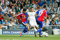 Cristiano Ronaldo of Real Madrid and Suchy of FC Basel 1893 during the Champions League group B soccer match between Real Madrid and FC Basel 1893 at Santiago Bernabeu Stadium in Madrid, Spain. September 16, 2014. (ALTERPHOTOS/Caro Marin) /NortePhoto.com