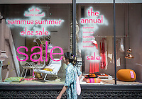 Summer sale is promoted in the window of the ABC Carpet & Home store in New York on Friday, June 26, 2015. (© Richard B. Levine)