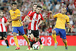 Athletic de Bilbao's Markel Susaeta (c) and FC Barcelona's Rafinha (l) and Javier Mascherano during Supercup of Spain 1st match.August 14,2015. (ALTERPHOTOS/Acero)