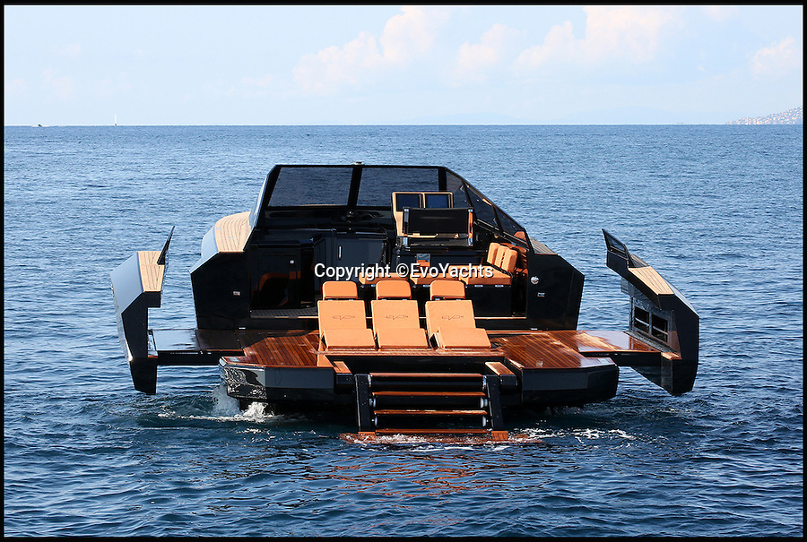 BNPS.co.uk (01202 558833)<br /> Pic: EvoYachts/BNPS<br /> <br /> The sides of the boat extend to make a party platform.<br /> <br /> This black luxury motorboat looks like it has been designed by Darth Vader as it has two expandable wings that slide out to create a 'party platform'.<br /> <br /> The sleek 42ft long craft looks like a normal speedboat until the touch of a digital control opens bulwarks at the rear to increase the cockpit space by 40 per cent.<br /> <br /> The quirky innovation appears to give the vessel angled wings resembling TIE Fighter craft in Star Wars.