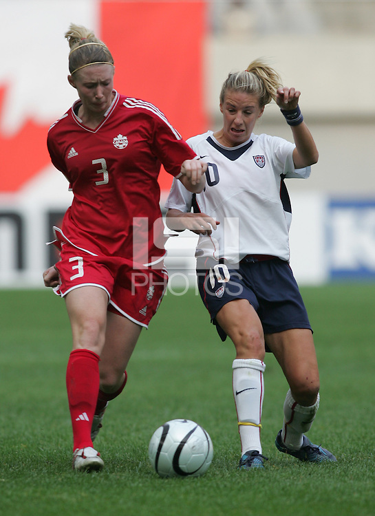 Nov 4, 2006: Seoul, South Korea:  USWNT midfielder (10) Aly Wagner tries to take the ball away from Canadian midfielder (3) Melanie Booth while playing in the Peace Queen Cup final at Seoul World Cup Stadium. The United States defeated Canada, 1-0.