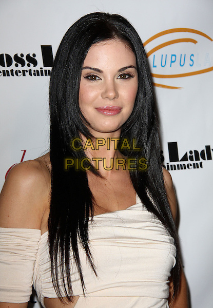 "JAYDE NICOLE . Lupus LA Raises Awareness with ""Get Lucky for Lupus"" held At Andaz Hotel, West Hollywood, California, USA..February 25th, 2010.headshot portrait white cream dress off the shoulder .CAP/ADM/KB.©Kevan Brooks/AdMedia/Capital Pictures."