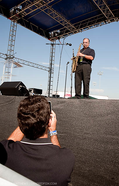 """The High Tech Texan, Michael Garfield records Joe """"Pags"""" Pagliarulo's saxaphone rendition of the Star Spangled Banner with his iPhone at the North Houston Tea Party."""