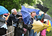 Washington, D.C. - April 21, 2008 -- Guests try to protect themselves from the rain and wind caused by the take-off of Marine 1 as United States President George W. Bush departs from the South Lawn of the White House for meetings in New Orleans, Louisiana with President Felipe de Jesus Calderon Hinojosa of Mexico and Prime Minister Stephen Harper of Canada.<br /> Credit: Ron Sachs / Pool via CNP