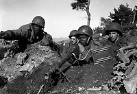 Fighting with the 2nd Inf. Div. north of the Chongchon River, Sfc. Major Cleveland, weapons squad leader, points out communist-led North Korean position to his machine gun crew.  November 20, 1950.  Pfc. James Cox. (Army)<br /> NARA FILE #:  111-SC-353469<br /> WAR &amp; CONFLICT BOOK #:  1426