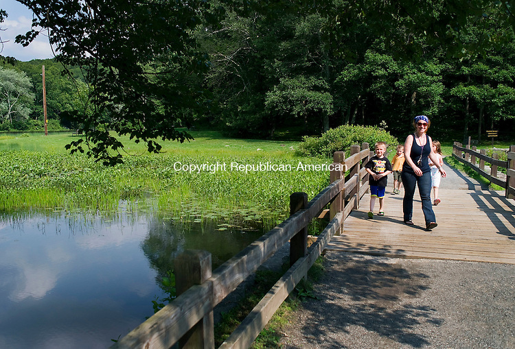 Southbury, CT- 01 July 2015-070115CM02- Tricia Bucci, front with her children, from left,  Edward, 6, Billy, 4 and Olivia, 6, walk along Papermill Pond at Southford Falls in Southbury on Wednesday.  The family, including husband Thomas Bucci, hiked through the State Park enjoying a summer afternoon.    Christopher Massa Republican-American