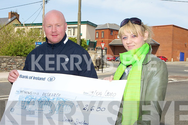 Derek Dalton presents a cheque for EUR2,600 which was raised at an 80's disco in listowel last weekend to Monika Marchlewicz Meningitis research Foundation.