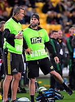 Hurricanes assistant coach Richard Watt (left) stops Cory Jane from touching the ball after it was kicked out during the Super Rugby match between the Hurricanes and Chiefs at Westpac Stadium in Wellington, New Zealand on Friday, 9 June 2017. Photo: Dave Lintott / lintottphoto.co.nz
