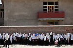 "15 June 2013, Dari Cha Noor School, Qargha, Kabul Province,  Afghanistan. School students line up at the Dari Cha Noor (""Window to Knowledge"") School. The school has begun to formulate plans to improve and expand under the  Education Quality Improvement Program (EQUIP). Currently they have only organised the shura council but already they have enrolled another 75 students in the last three months. The school will benefit from the EQUIP whose objective is to increase access to quality basic education, especially for girls. School grants and teacher training programs are strengthened by support from communities and private providers.  Picture by Graham Crouch/World Bank"